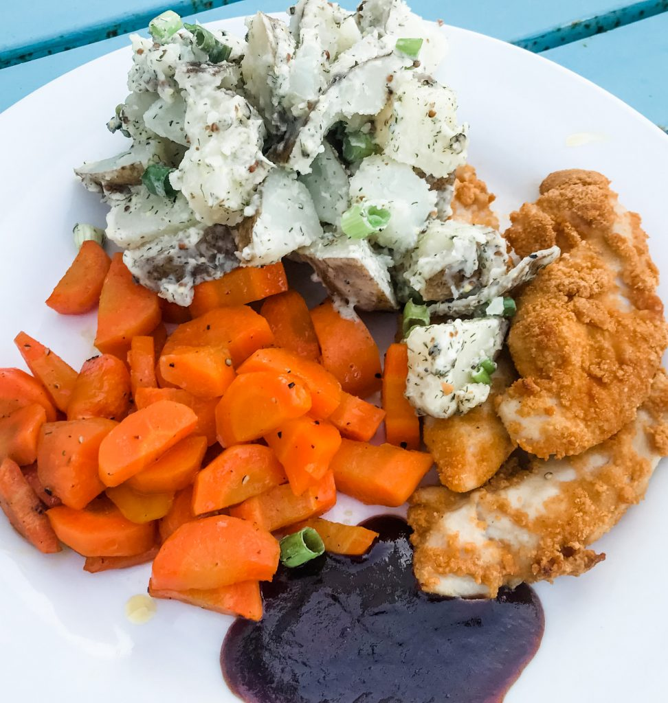 chefs plate chicken tenders and carrots